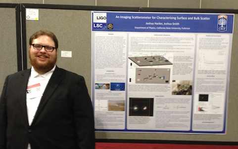 Josh Hacker presents a poster on his LIGO-related optics research.