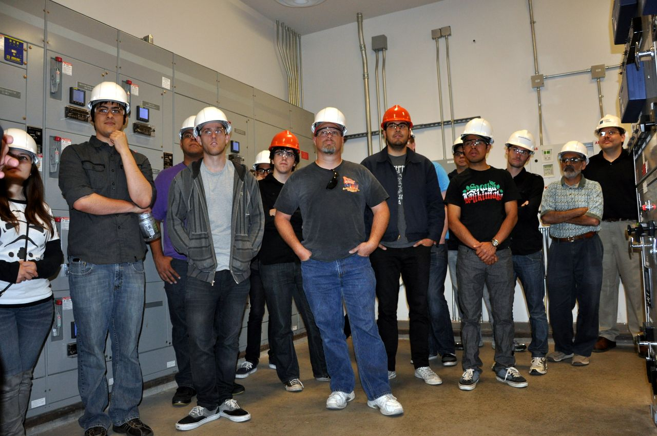 Greg (far right) with students and faculty on a tour of the campus energy-control 'trigen' plant