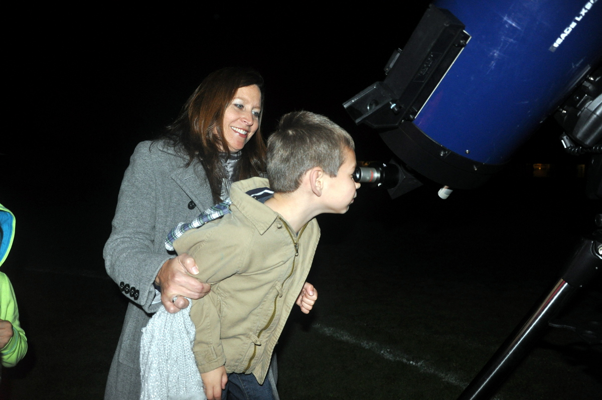 Mother and son viewing the stars.